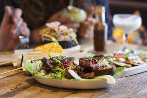 A collection of Mexican dishes in soft focus.