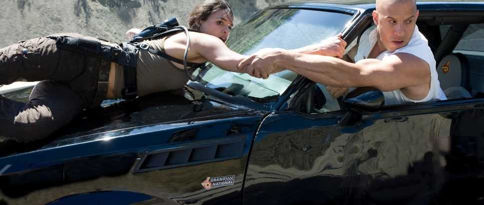 Michelle Rodriguez (as Letty) and Vin Diesel (as Dom) in Fast & Furious