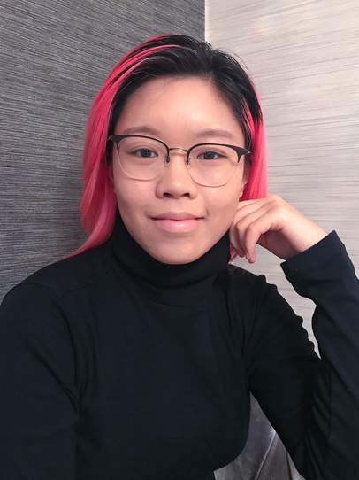 Portrait photo of Karlie Wu; Karlie wears glasses and a black turtleneck jumper, against a grey background