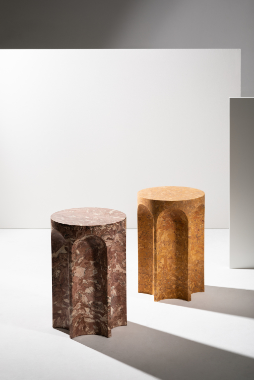 A pair of hexagonal side tables in various brown shades, against a white and grey background