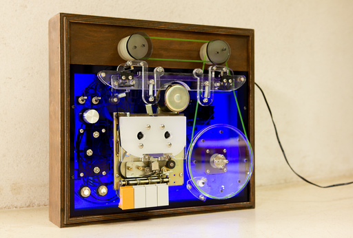 Lomond Campbell's LUP machine; a blue box with a cassette deck at its centre, with cogs and dials of various sizes dotted around the machine.