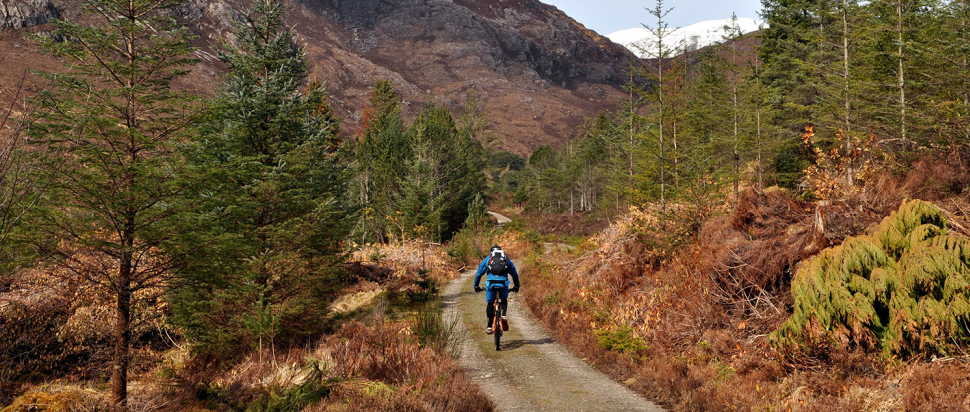 Steve Peat rides a fire road in Wester Ross